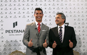 Portuguese player Cristiano Ronaldo poses with Dionisio Pestana, President of the Pestana Group, during a publishing event in Lisbon, Portugal December 17, 2015. The Pestana Group, the largest hotel group in Portugal, established a partnership with soccer player Cristiano Ronaldo for a joint investment of 75 million euros in four new hotels in Lisbon, Funchal, New York and Madrid. REUTERS/Rafael Marchante - RTX1Z5XA